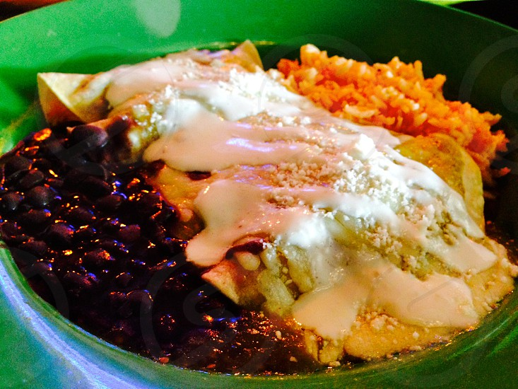 Enchiladas with black beans and rice photo