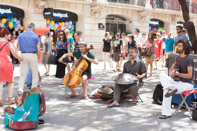 street performers on street with crowd of people photo