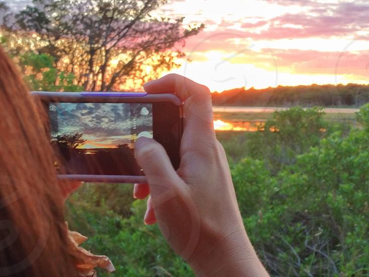 Photographing a photographer photographing a sunset. Cape Cod MA.  photo