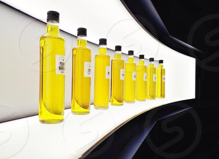 white labeled bottle with yellow liquid in panoramic photography photo