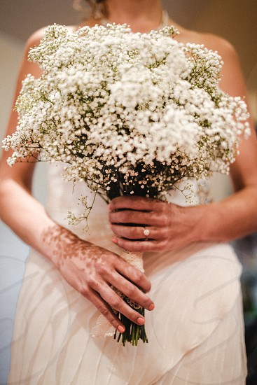 Woman Wearing White Dress Holding White Flowers photo