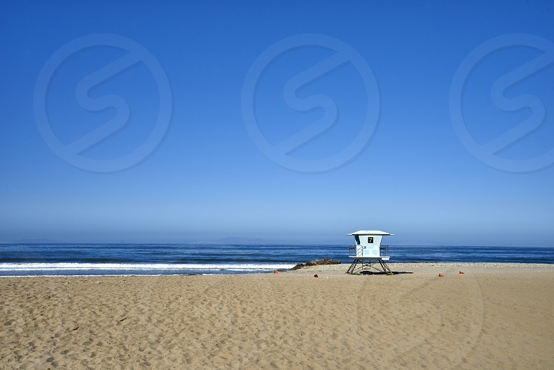 Seascape of pacific ocean sand and waves; lifeguard station #7  photo