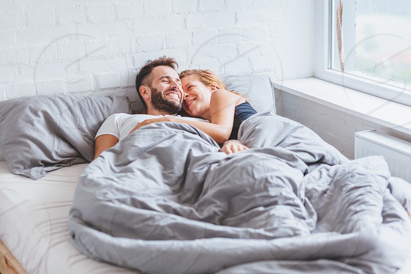 Young couple enjoying bed time in the morning photo