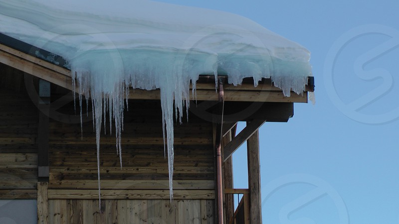 French Alps Val d'Isere iceicles on roof photo