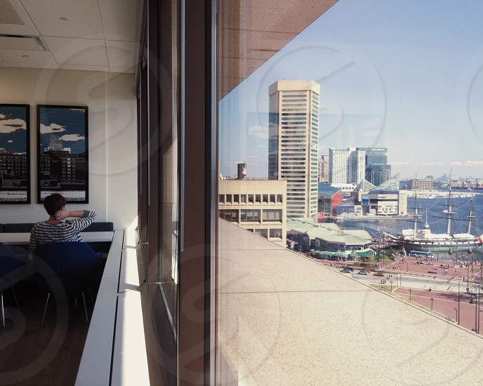 View of Baltimore's Inner Harbor from inside the Transamerica Tower (includes the Baltimore World Trade Center The Baltimore Aquarium and the USS Constellation). (architecture view window city look daydream) photo