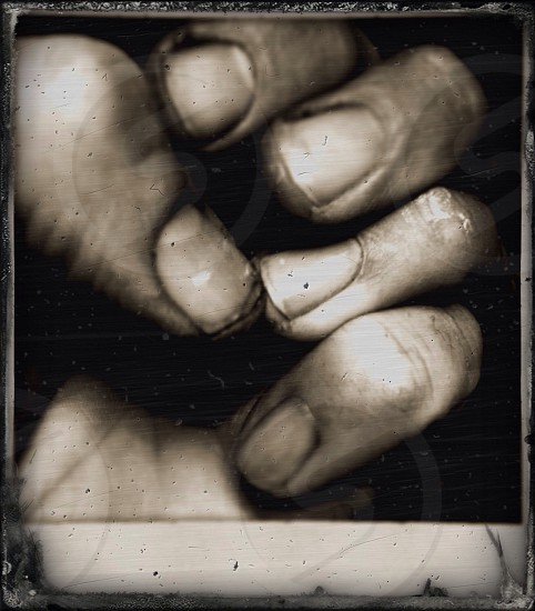 left hand in grayscale photography  photo