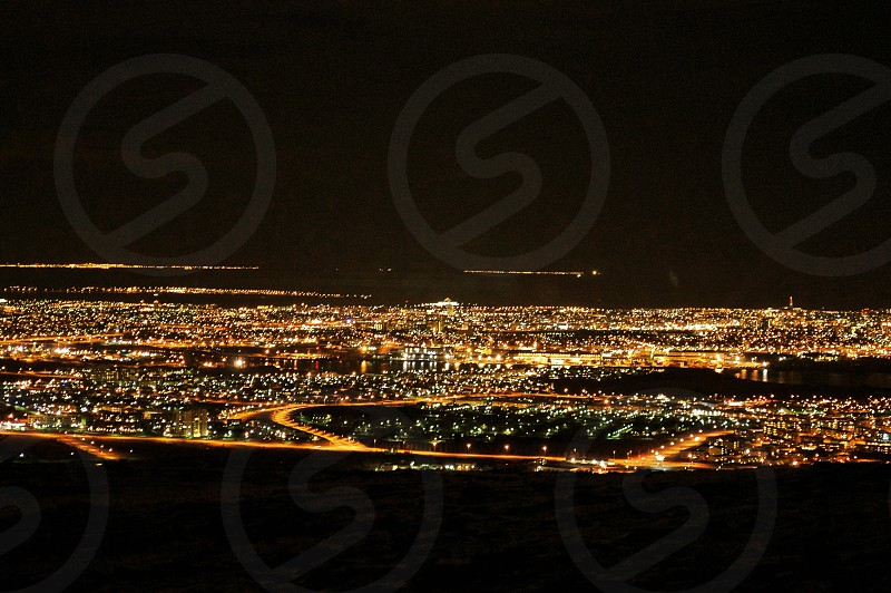 aerial view of city buildings with lights at night photo