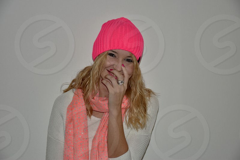 Portrait of the young woman with the pink hat and scarf photo