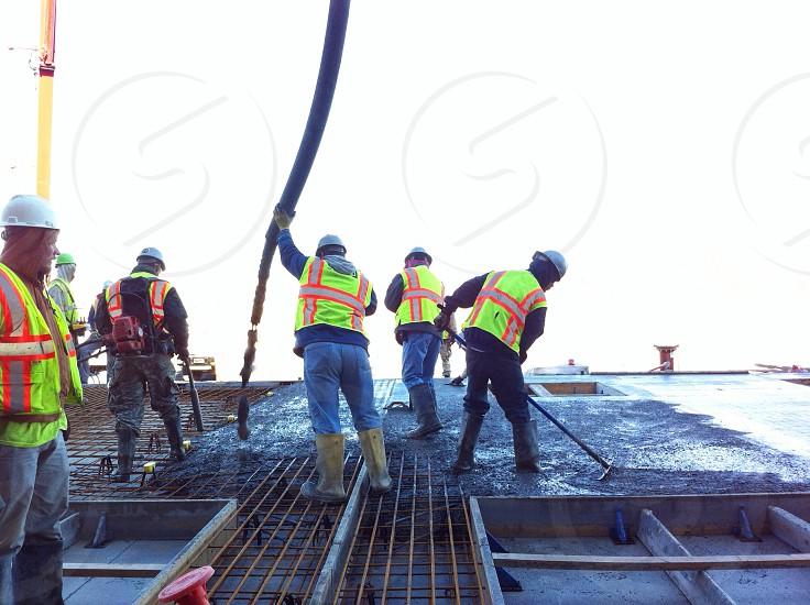 5 men doing construction work photo