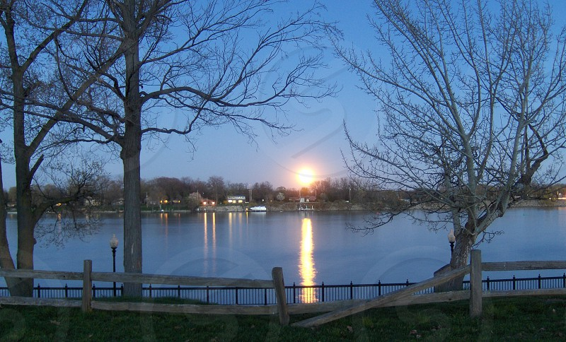Full moon rising over the Detroit River. photo