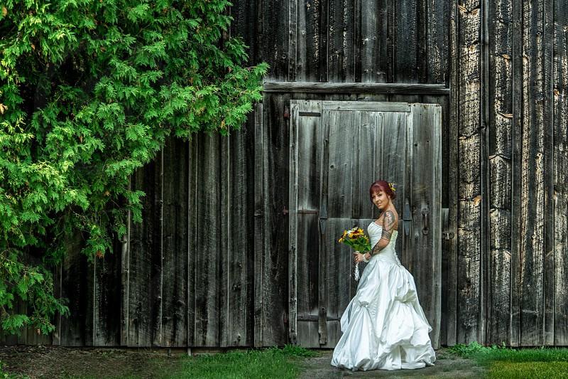 Wedding wedding dress dress bride bridal model wooden wooden door barn barn door tree white sunflower summer wedding season season texture green neutral brown photo