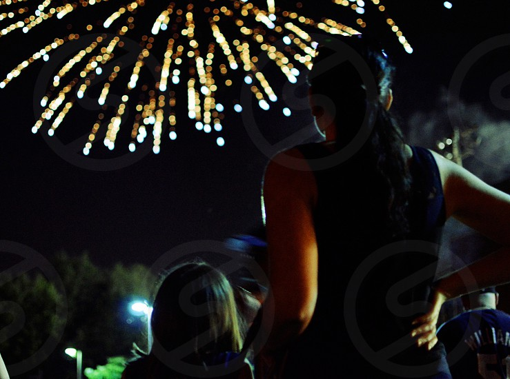 woman and child in dark watching fireworks photo