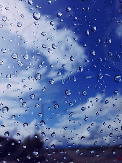 water droplets on clear glass photo