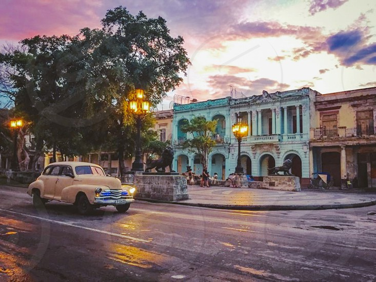 Outdoor day horizontal Havana Cuba sunset storm stormy Sky clouds cloudy car 1950s vintage architecture buildings  photo