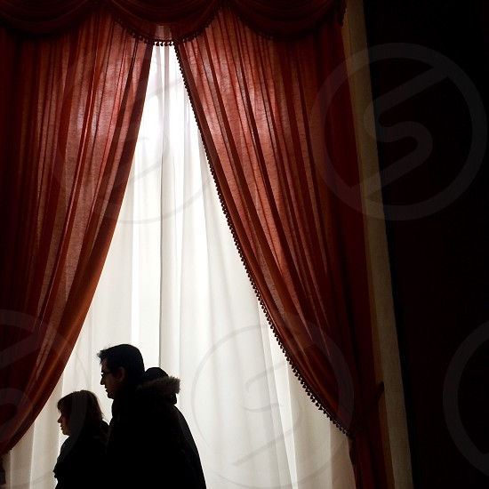 A couple admire a piece of art in the Salvador Dali Museum in Figueres Spain. photo