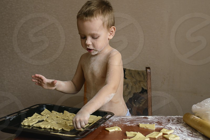 boy baby cooking cookies candy home handmade family food photo