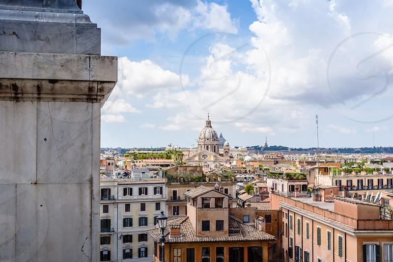View of Rome from Piazza della Trinita dei Monti a sunny summer day. Vatican dome on background photo