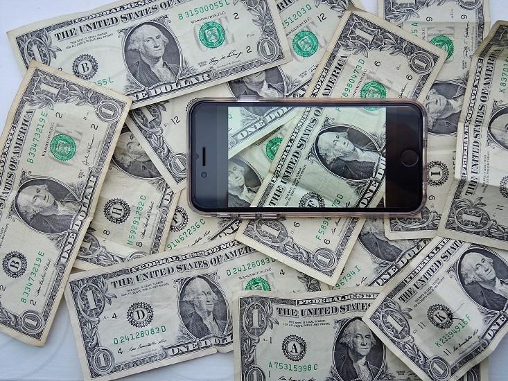 space gray iphone 6 on 1 u.s dollar bill photo