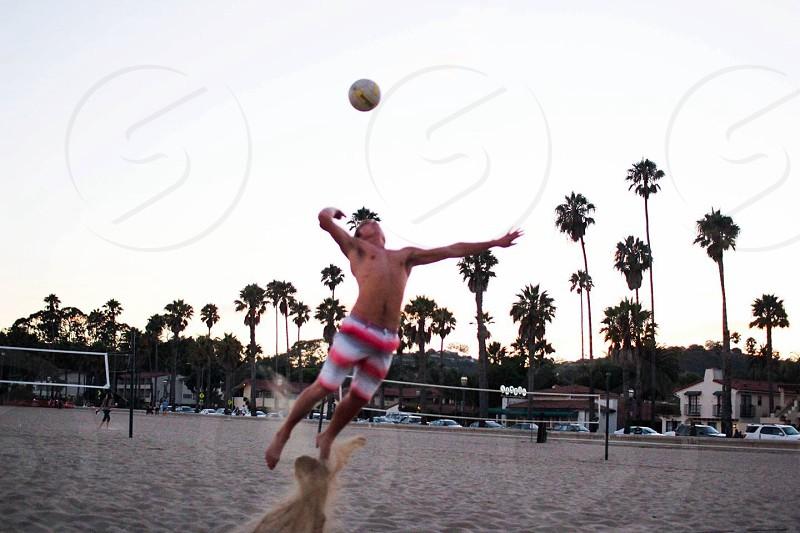 man jumping to hit ball photo