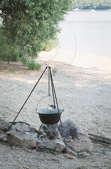Black Cauldron on Tripod on the River Bank photo