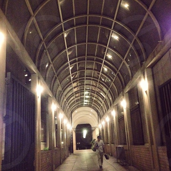 One of the many arched walkways and corridors in Manhattan New York City.   photo