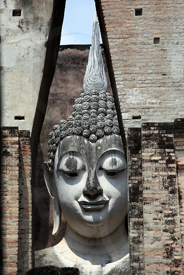 the Wat Si Chum Temple at the Historical Park in Sukothai in the Provinz Sukhothai in the north of Bangkok in Thailand Southeastasia. photo