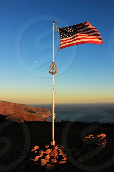 Flag patriot patriotic U.S. landscape beach mountain hike climb coast California Cali SoCal Malibu highway1 pch wind windy blowing view color sky moon horizon symbol freedom America boys scout troop  photo