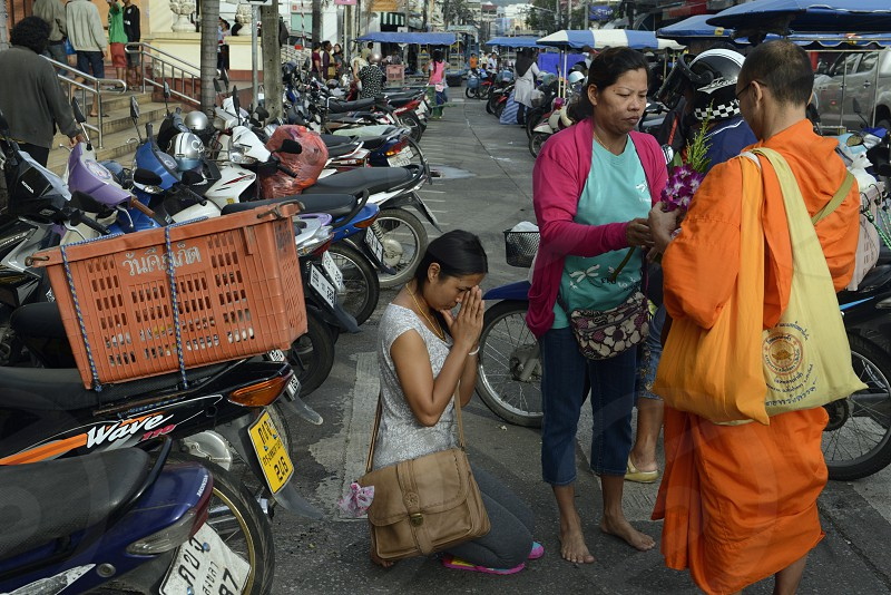 people praying at the day Market in the city of Phuket on the Phuket Island in the south of Thailand in Southeastasia. photo