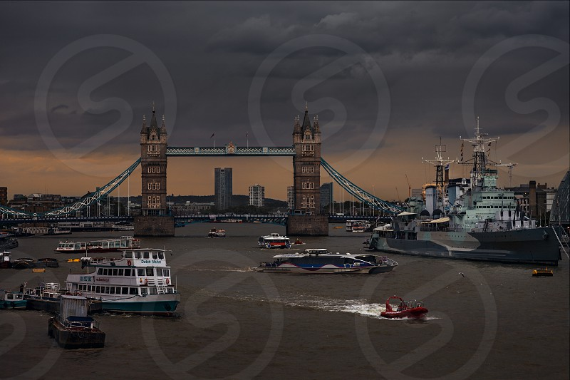 Traffic on River Thames Tower Bridge London England photo