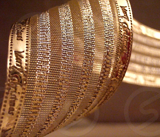 A gold mesh holiday ribbon is seen in extreme close-up. photo