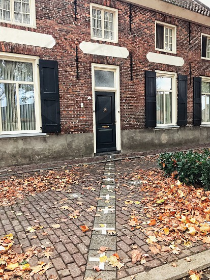 autumn leaves door frontier belgiumnederland baarle hertog house photo