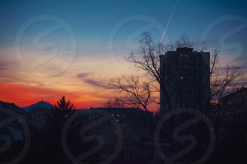 Sunset over a small Balkan town early spring season Cacak city in Serbia. photo