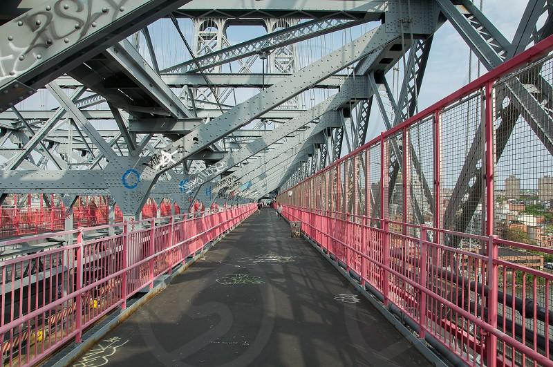 people walking on steel bridge industrial photography photo