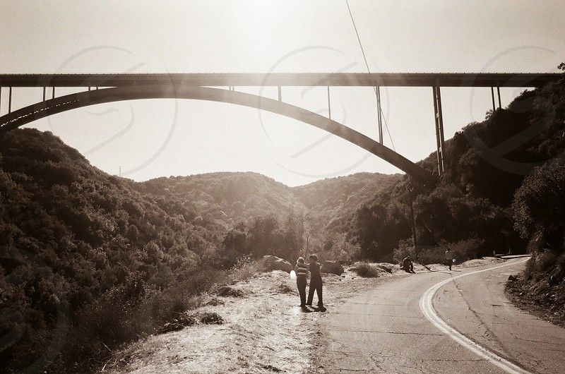 A daughter holds her mother after seeing the bridge where her son committed suicide.   Cold springs bridge   photo