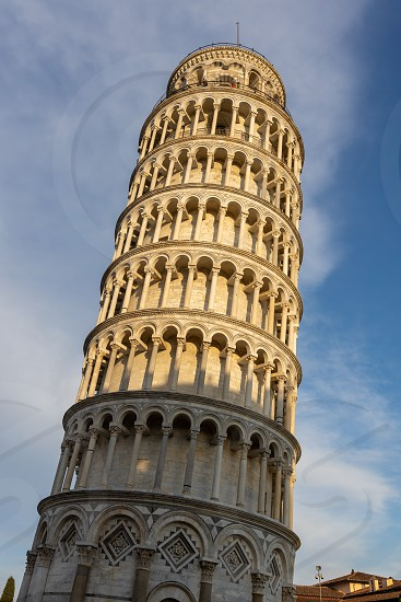 PISA TUSCANY/ITALY  - APRIL 18 : Exterior view of the Leaning Tower in Pisa Tuscany Italy on April 18 2019. unidentified people photo