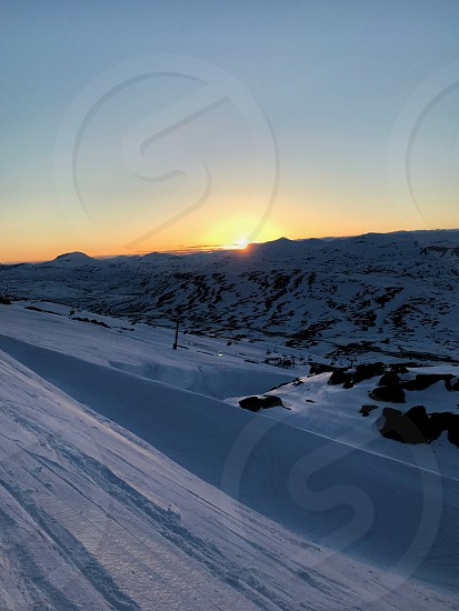 Sunset skiing in the summer photo