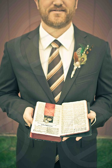 man holding open book photo