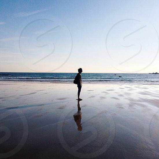 view of man on sea shore photo