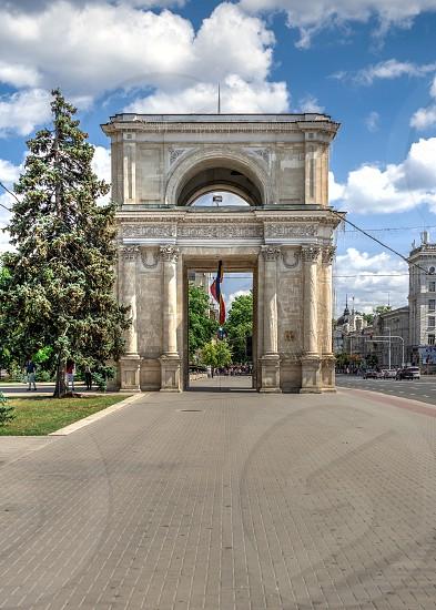 Chisinau Moldova – 06.28.2019. Triumphal arch in the center of Chisinau capital of Moldova on a sunny summer day photo