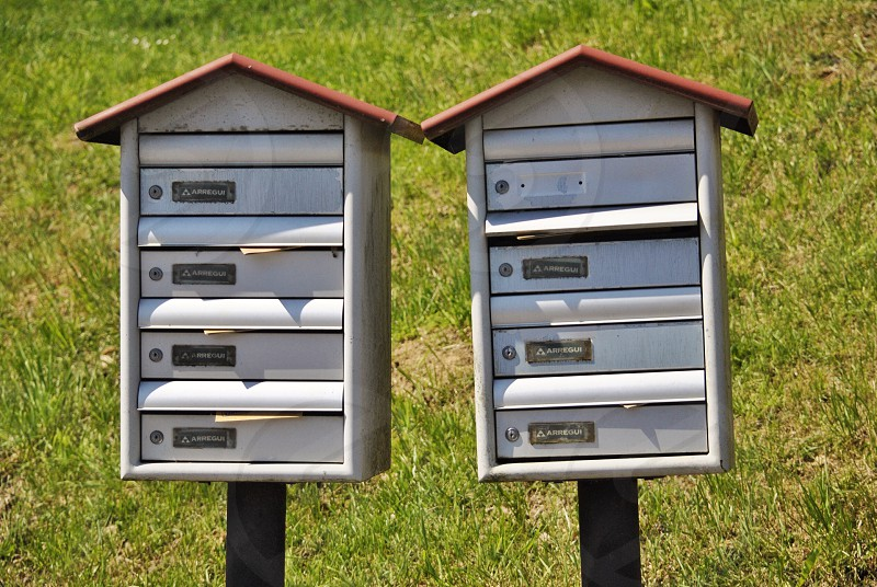 2 multi layered  white red mail boxes photo
