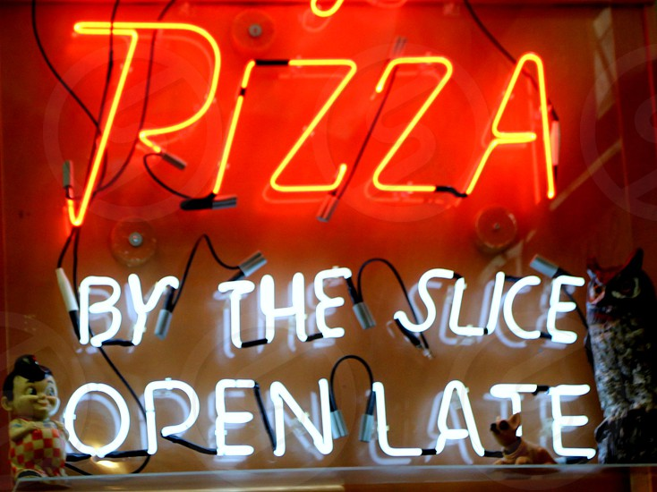Pizza by the slice open late sign photo