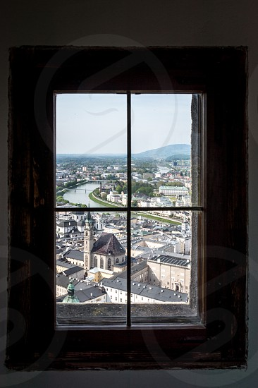 Framed view of Salzburg. Window glass landscape city cityscape imperial framed aerial view top view river european culture Mozart photo