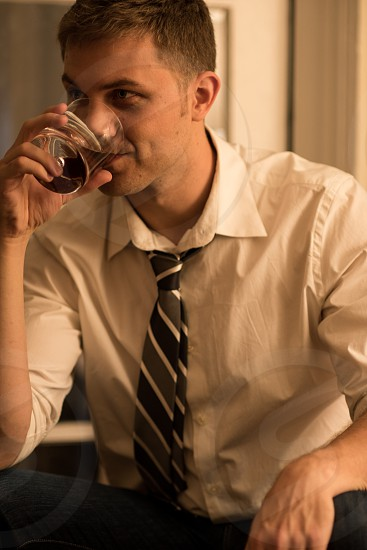 Young Professional Man Drinking  photo