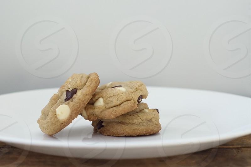 Group of three chocolate chip cookies. photo