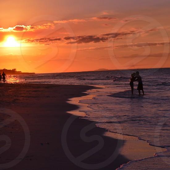 beach kissing couple photo