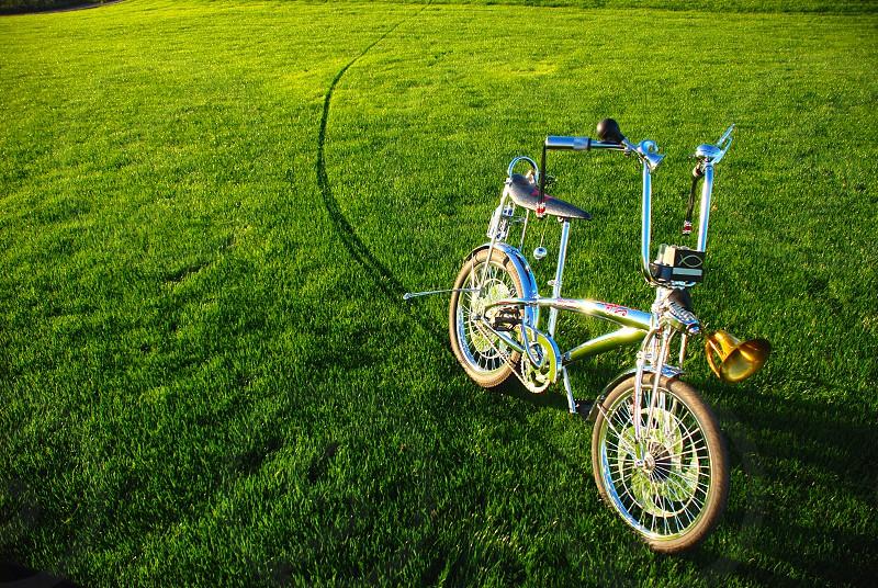 Bike on green lawn green bicycle chrome photo
