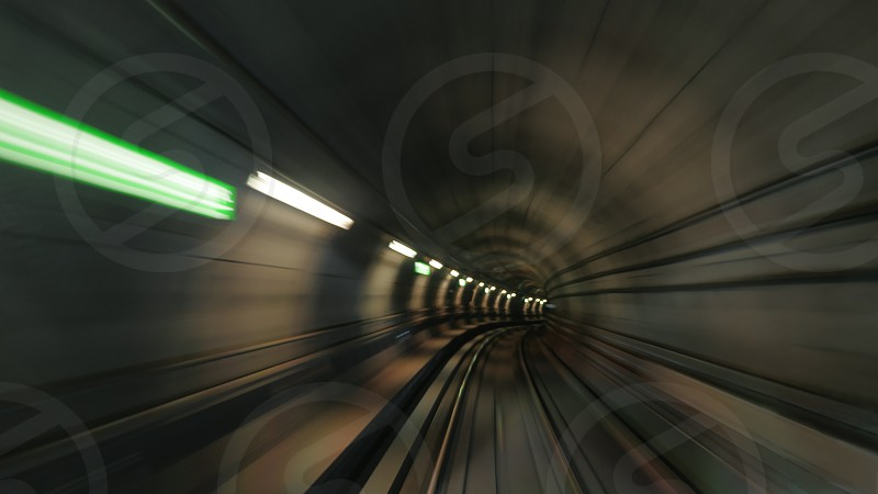 Blurred view on subway tunnel in motion photo