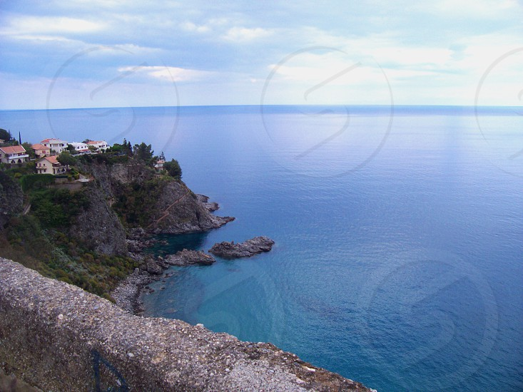 houses on cliff on sea side photography photo
