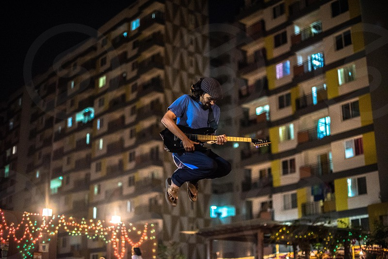 Freedom to be free..   Vishnu chooses to do what he wants - that's play music.. and well more than what you hear him play - you really see him enjoy - even when he's not playing. A true free spirit out there in Bangalore India - creating waves in corners of the city photo