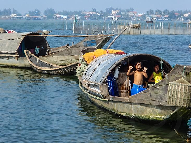 Vietnam fishing village children off the beaten path. photo